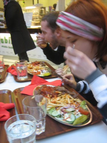 Our first day there we came off the plane really hungry. We found a place that served troughs of food for under 7 Euros. Eszter, the small woman in this photo, ate the entire plate. She is a champion.